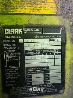 Clark electric forklift with roll clamp and battery charger. Needs battery